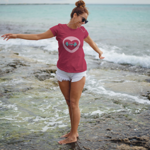 Love-Lift trendy-girl-at-the-beach-wearing-a-round-neck-tee-mockup-and-shorts-a12727